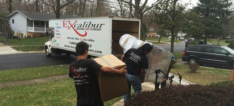 gold moving services in MD - movers taking stuff to a moving truck