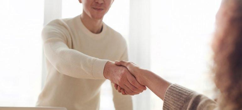 moving services Rockville MD - a handshake