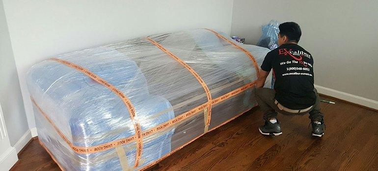 a man packing a sofa