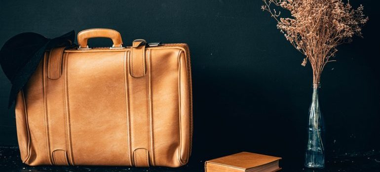 A brown leather bag packed for moving in Rockville