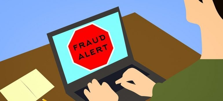 """Fraud alert"" sign"