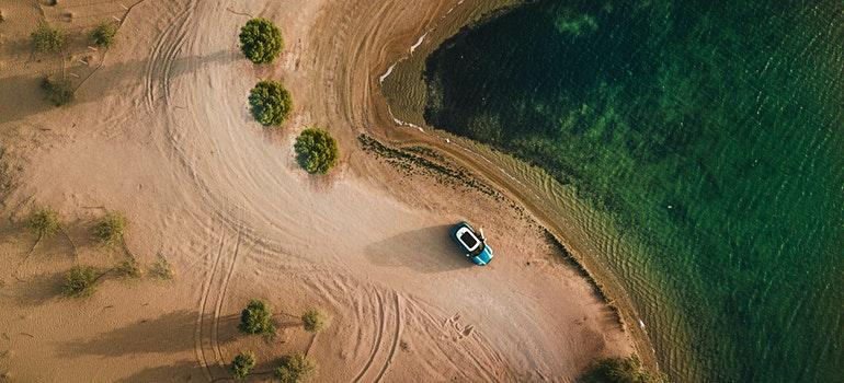 car on a beach from an aerial view