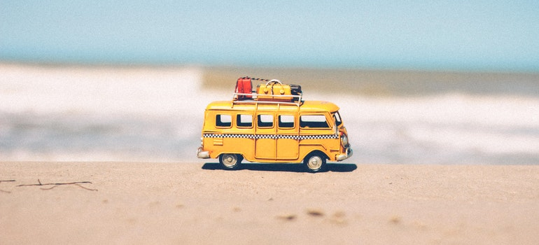 Van on a beach for your summer move to Gaithersburg