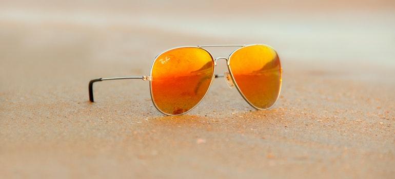orange sunglasses on a beach