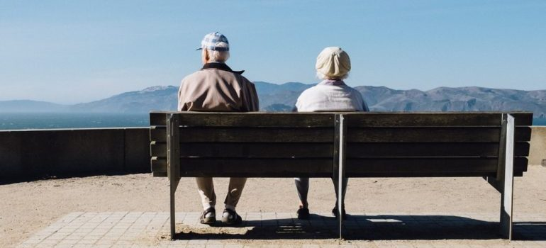 Two seniors on a bench