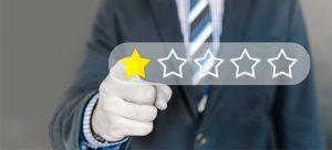 a man pressing a star rating