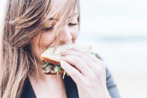 A woman eating a sandwich