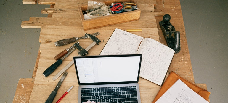 A home office of a woodmaker with a laptop on the table.