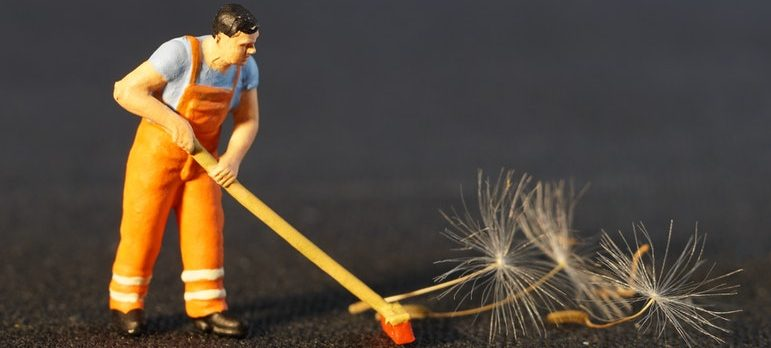 a miniature of a man performing a move out cleaning