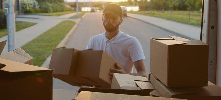 a guy loading the van